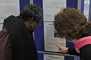 Angela Hilaire and Sheila Campbell spot their quotes in the exhibition